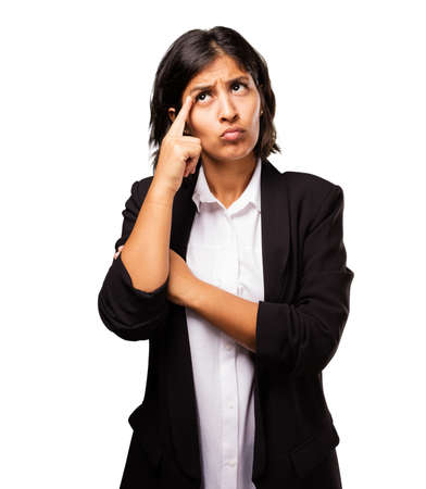 uneasy: latin business woman thinking