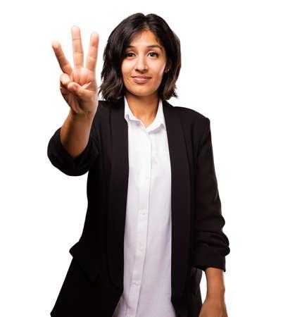 Donna di affari latina che fa bottone tre pollici Archivio Fotografico - 81142200