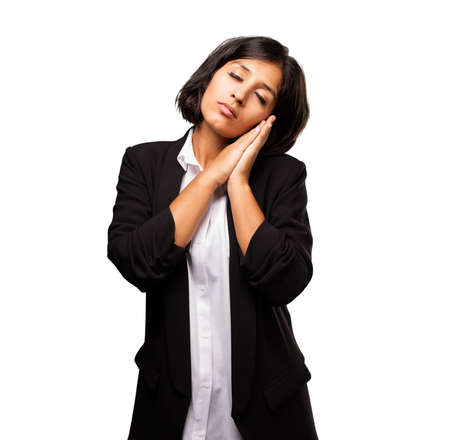 latin business woman doing sleeping gesture