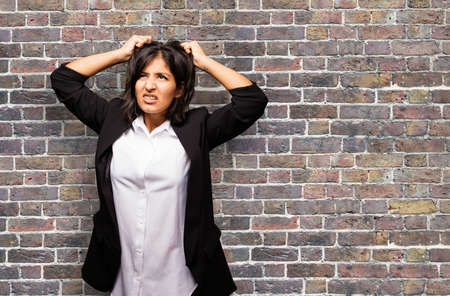 latin business woman stretching her hair Stok Fotoğraf