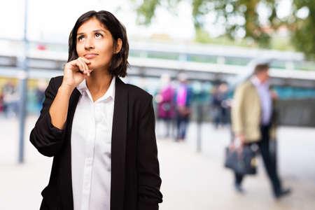 latin business woman thinking