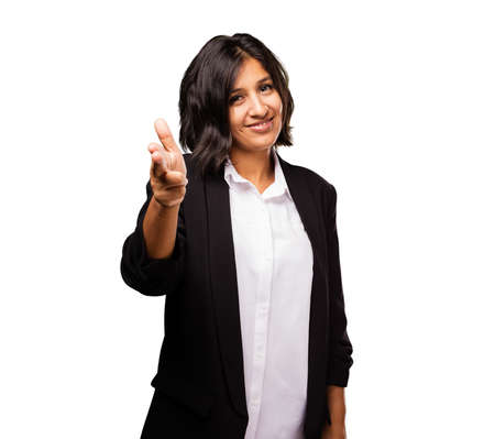 latin business woman doing gun gesture