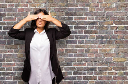 latin business woman covering her eyes