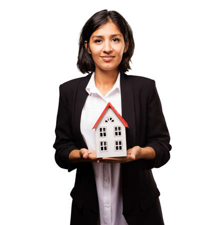 latin business woman holding a house