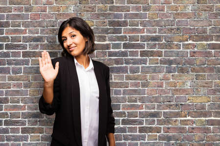 latin business woman doing stop gesture
