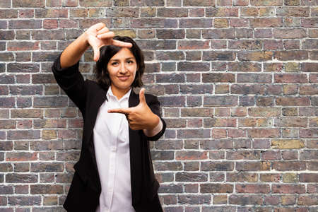 latin business woman doing frame gesture