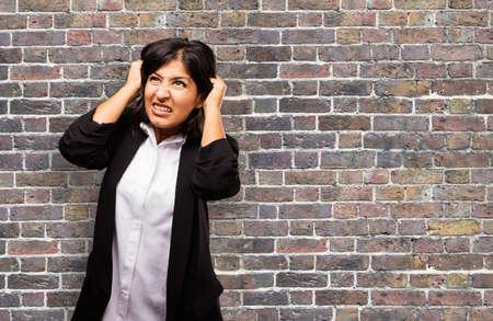 latin business woman stretching her hair Banco de Imagens