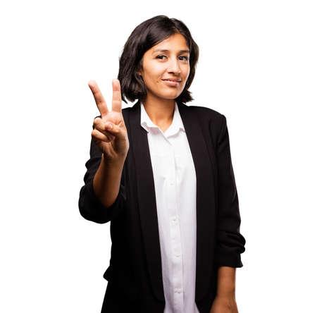 latin business woman doing victory gesture Stok Fotoğraf