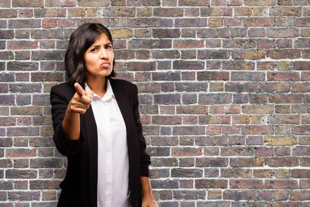 provoked: latin business woman pointing front