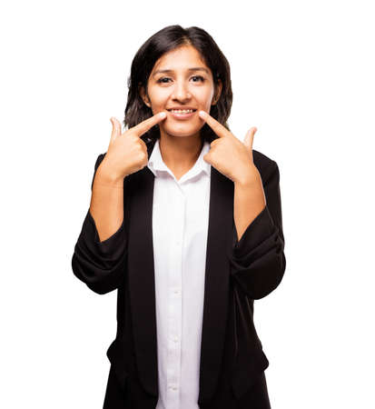latin business woman pointing her mouth Stock Photo