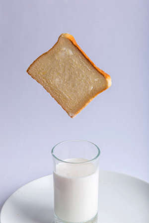 Closeup bread top milk glass