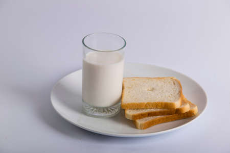 closeup bread slice milk glass in plate