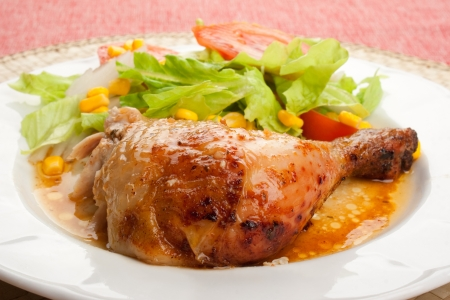 roast chicken leg  with mixed salad in a dish