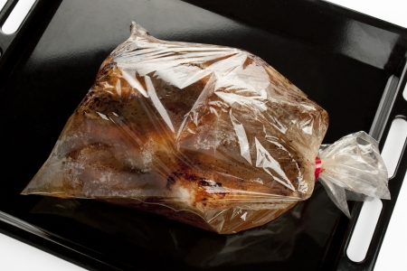 plastic made: roast chicken into a oven bag on a baking tray