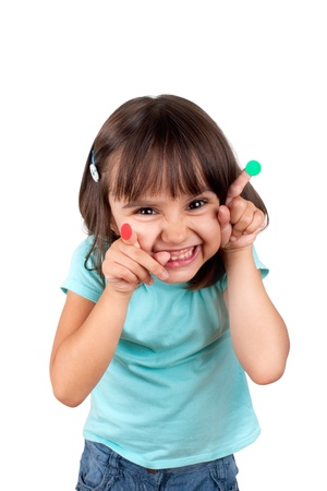big teeth: Naughty little girl with round stickers on fingers, one red and one green. Good or bad? Isolated.
