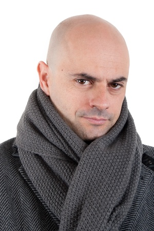 shaved head: Portrait of a bald man in tweed coat and grey scarf loking at camera with half smile  Isolated