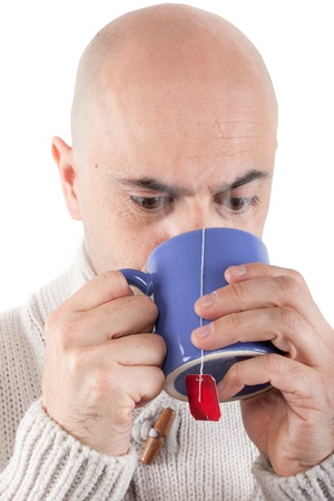Bald man with jersey drinking a steaming hot drink in a mug  Stock Photo - 17210595