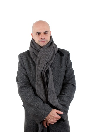 Kind bald man wearing winter tweed coat and long scarf with hands crossed  Isolated