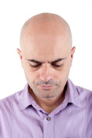 bald head: Portrait of a serious and worried  bald man looking down  Lilac shirt  Isolated  Stock Photo
