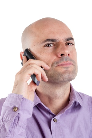 Portrait of a serious bald man looking up while on mobile phone  Expression of disbelief Lilac shirt  Isolated Stock Photo - 17210589