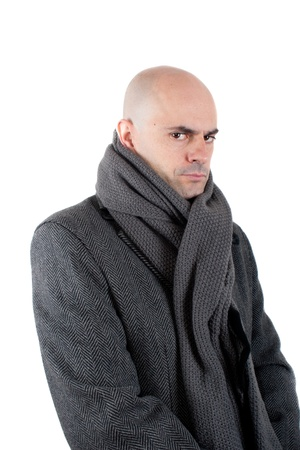 Serious and angry bald man wearing  tweed coat and scarf  Looking at camera  Isolated  photo