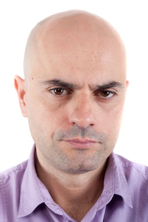 frowning: Closeup of a serious and angry bald man looking at camera  Lilac shirt  Isolated  Stock Photo