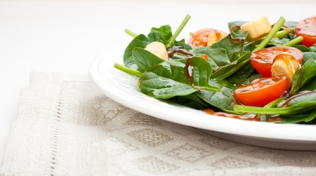Salad of spinach, tomato cherry and croutons with olive oil and balsamic vinegar syrup  Widescreen  Stock Photo
