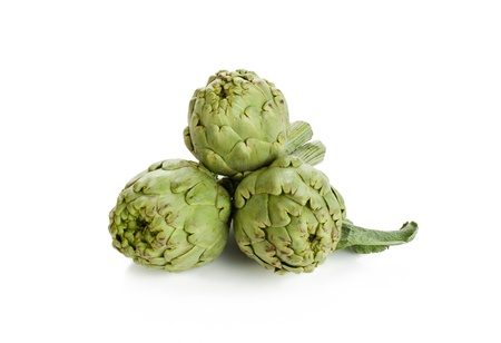 Three artichokes with steam and leaf  Isolated