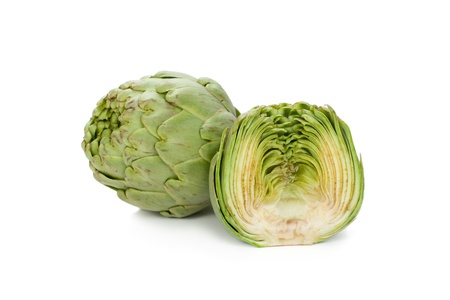 Two artichokes, one showing its heart  Isolated photo
