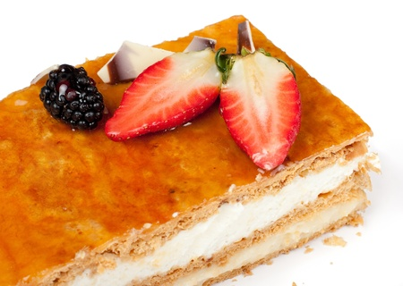 cream puff: Puff pastry pie with custard and cream, decorated with fresh strawberries, blackberries  and mixed chocolate flakes  Isolated Stock Photo