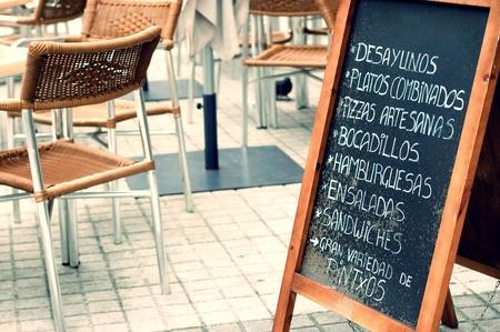 Tabloid offering fast food in an empty terrace in San Sebastian, Spain  Vintage effect edition