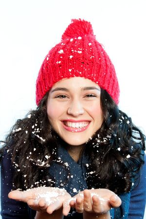 fake smile: Happy young woman with fake snow in hands, face and hair laughing