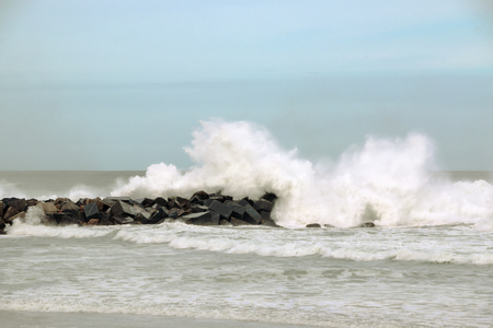 cantabrian: Waves breaking on the breakwater at high tide