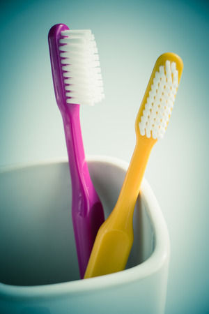 Colorful toothbrushes in a mug photo