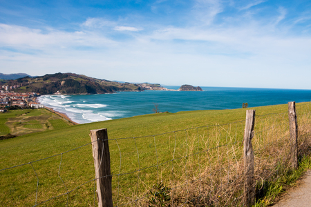 View of Zarautz and Getaria from mount  A roadside fence in foreground
