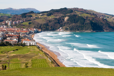 View from the mountain of the village of Zarautz with its beach and the golf course in the foreground