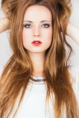 Beautiful fashion blonde girl tossing hair photo