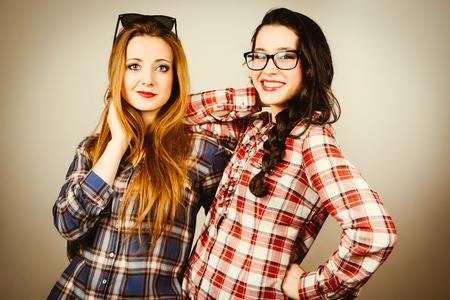 Funny hipster girls with plaid shirt and retro eye glasses. Retro filter effect added. photo