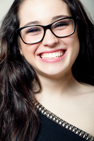 black rimmed: Attractive girl with black rimmed glasses laughing Stock Photo