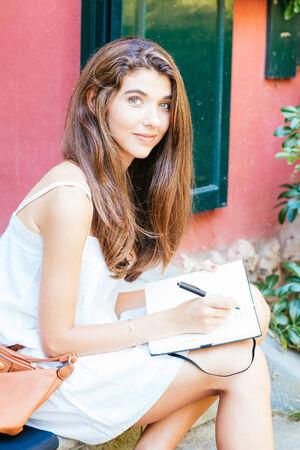 Beautiful girl working outdoors photo
