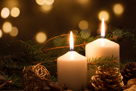 candlelight: Christmas candles and ornaments over dark background with lights Stock Photo