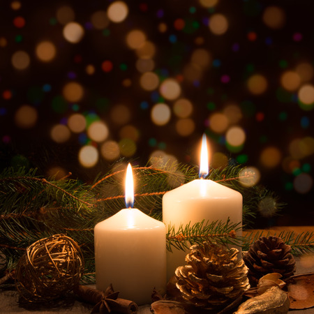 Christmas candles and ornaments over dark background with lights Stock Photo