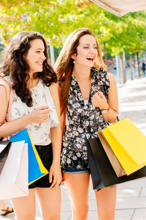 Laughing girls having a good shopping and fun Stock Photo