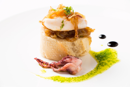 san sebastian: Squid with caramelized onion, parsley a nd some drops of vinegar syrup over a bread slice, called in the Basque Country as Pelayo squids