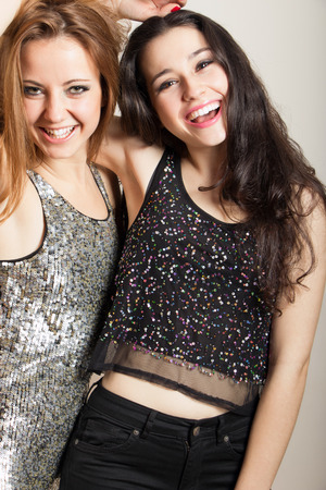 Beautiful party girls in sequins clothes having fun photo