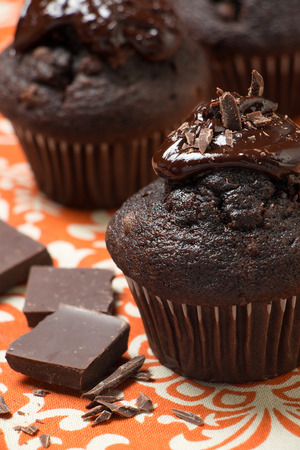 Chocolate muffins with melted chocolate and chips Stock Photo