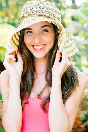 happines: Happy and beautiful girl with pamela smiling outdoors Stock Photo
