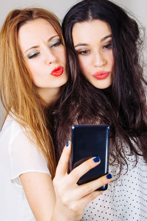 pouting: Funny girl friends pouting for a selfie Stock Photo