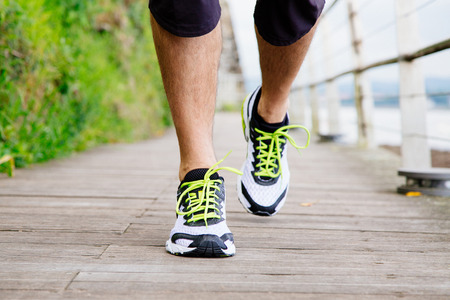 jogging track: Legs and shoes of a running man