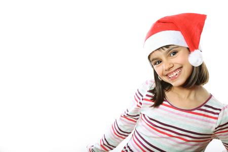 birretes: Retrato de una niña linda con sombrero de Santa sonriendo Foto de archivo